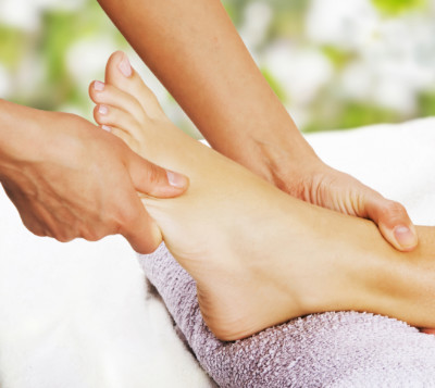 Massage therapist giving a foot massage in Charleston, SC